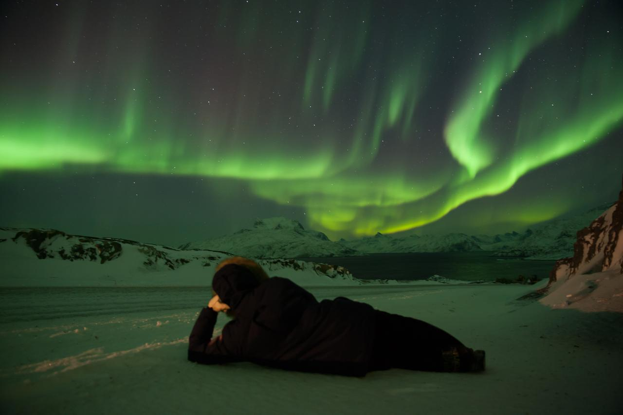 stock-photo-watching-aurora-borealis-127989293.jpg